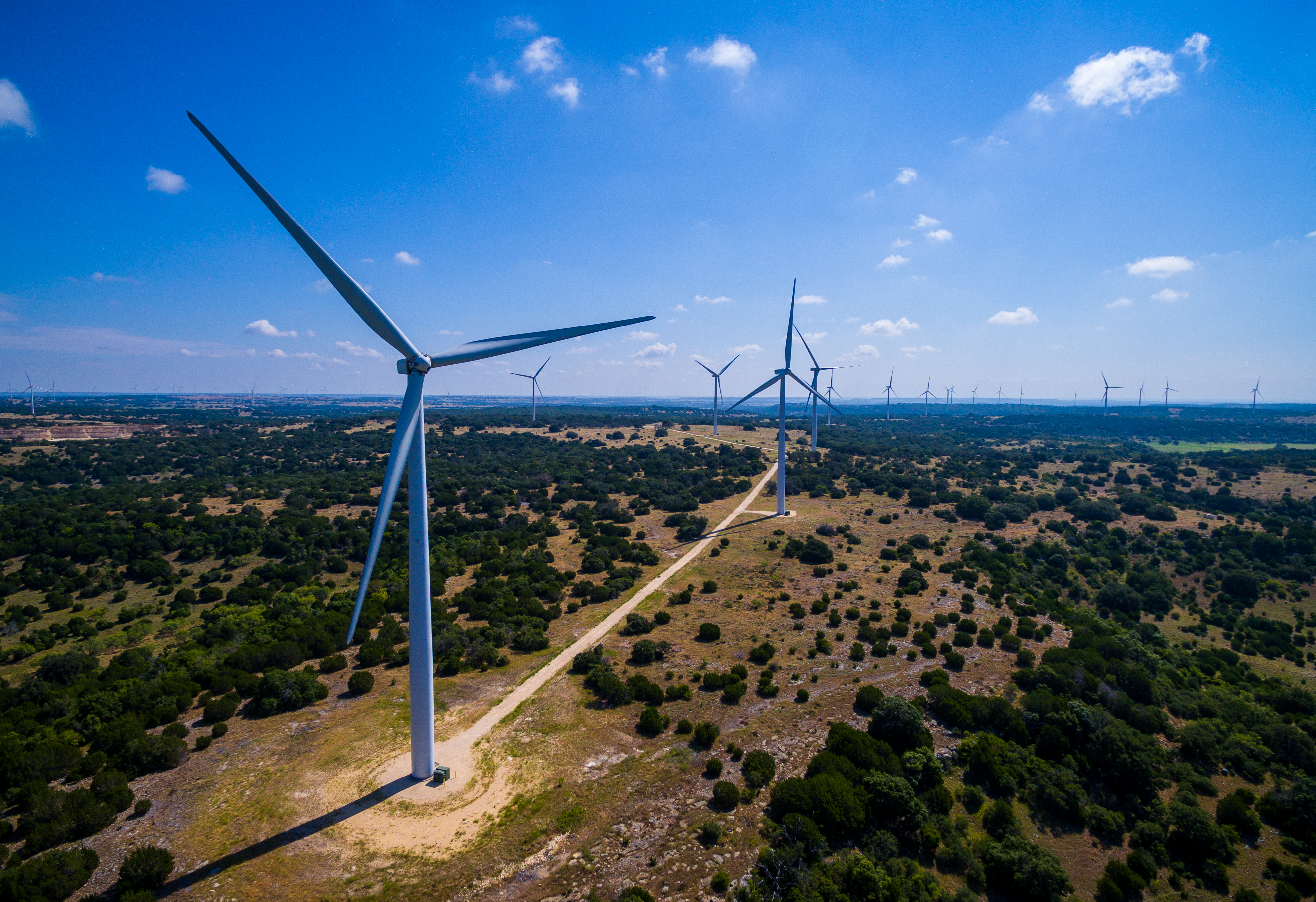 Amazing Aerial Wind Turbine Farm Goldthwaite Texas New wind Turbine Farm in central Texas. This large vast renewable energy and sustainable electricity at a cheaper cost than oil and gas fossil fuels. This clean wind farm will power thousands of homes.